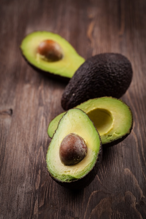 Avocado on wooden table