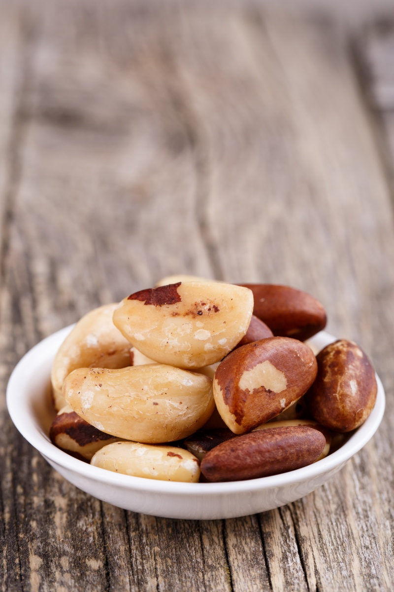 Brazil nuts on a white plate.