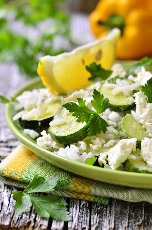 Zucchini with rice,brynza and parsley.