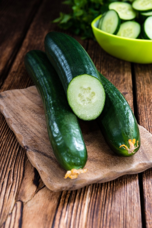 Portion of fresh and healthy Cucumbers (close-up shot)