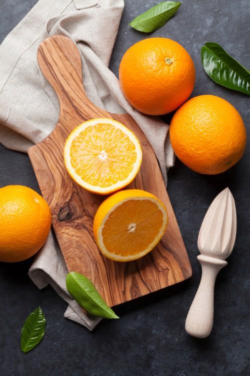 Fresh orange fruits on stone table. Top view