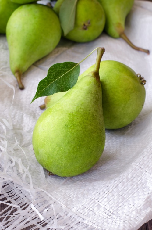 Healthy organic green pears on. Close up photo.