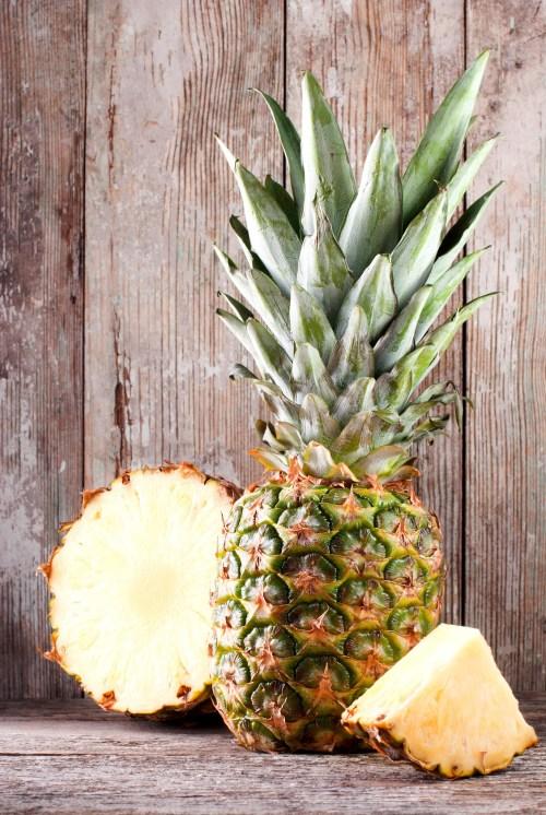 sliced ripe pineapple on the table