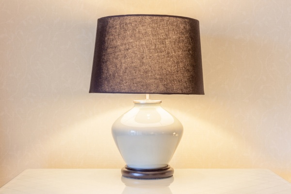 Table lamp and its shadow on wallpaper in the bedroom for decoration