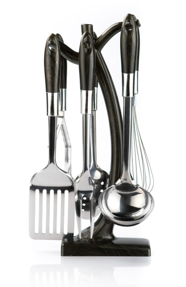 kitchen utensils hanging on white background.