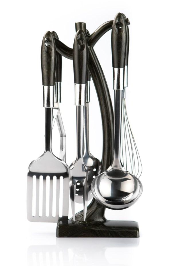 kitchen utensils hanging on white background.