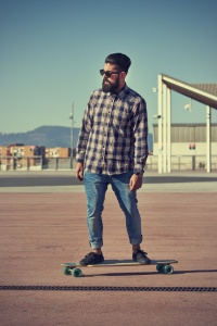 Man riding on a longboard skate