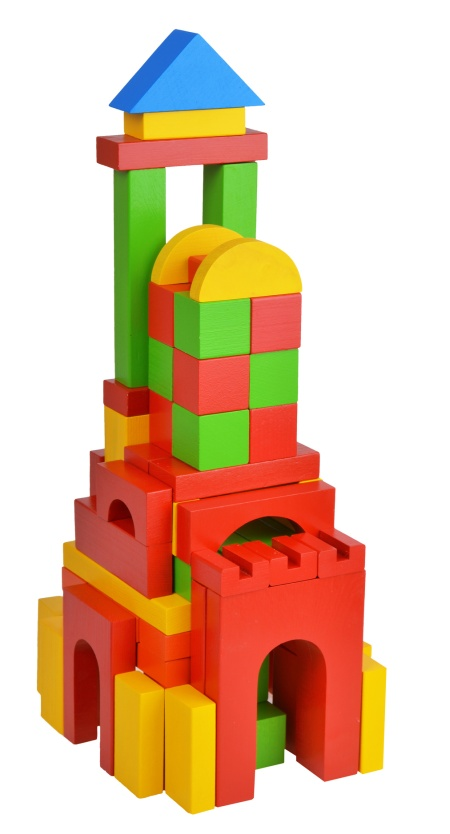 House with natural colored toy blocks on white isolated background