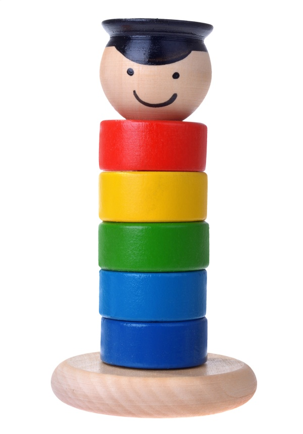 Pyramid build from colored wooden rings with a mans head isolated